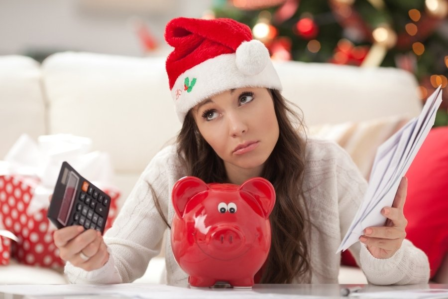 woman holiday planning to save money