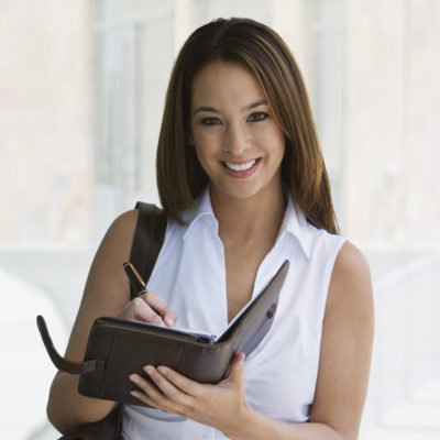 Woman checking the best steps to improve her credit score.